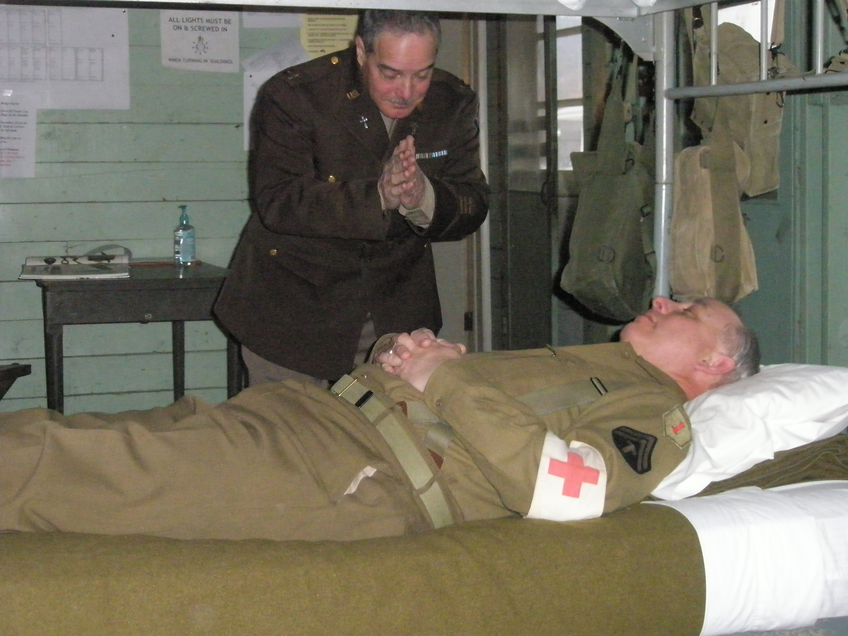 Chaplain Russ Kirby attends to Medic Shope