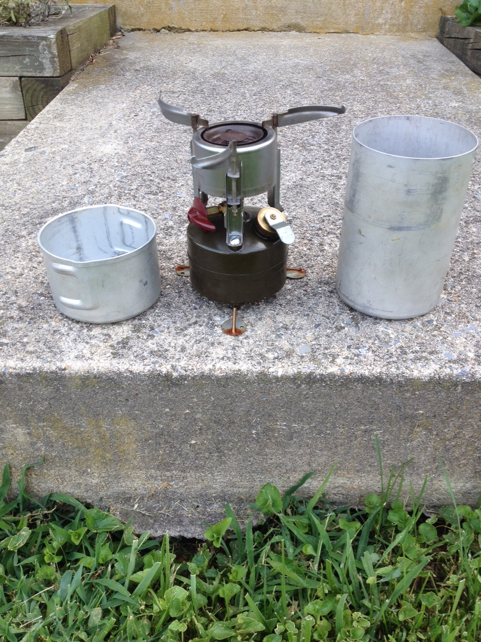 G.I. Stove 1948 and on to Viet Nam. Green front, a bit bigger, different burner arrangement. Can is the same as 1944