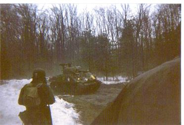 BATTLE OF THE BULGE 1996, TOM GRAY IN FOREGROUND WITH FRANK BUCK'S M4-A3 SHERMAN IN THE BACKGROUND. SNOW ON THE GROUND, BUT IT WAS 50 DEGREES AND RAINING.
